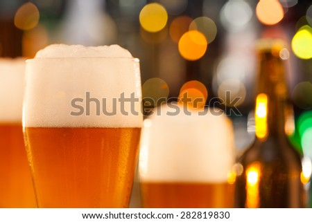 Close-up of jug of beer placed on bar counter - stock photo