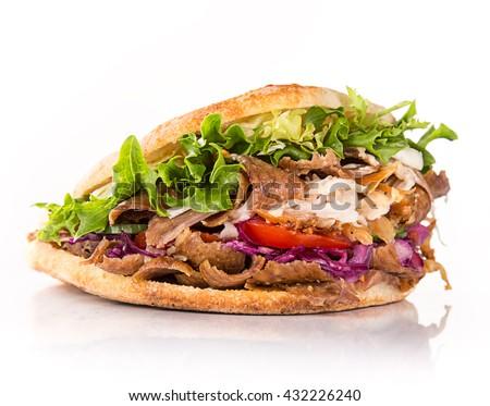 close up of kebab sandwich on white background - stock photo