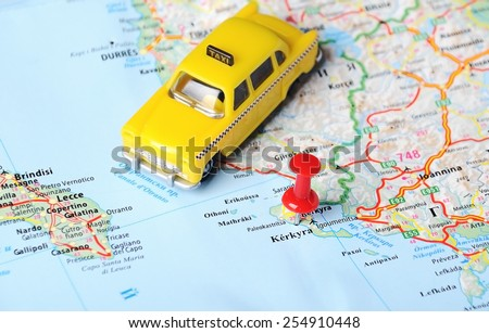 Close up of Kerkyra island , Greece map and taxi toy - Travel concept - stock photo