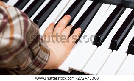 Close up of Keyboard of synthesizer. Music abstract background with hands playing on keyboard.