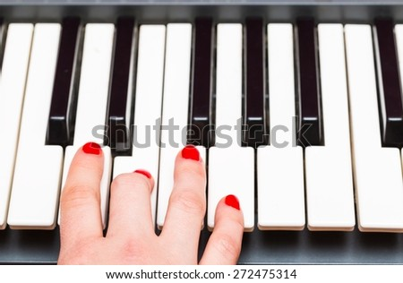Close up of Keyboard of synthesizer. Music abstract background with hands playing on keyboard. - stock photo