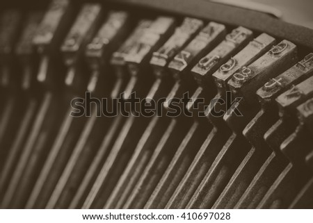 Close up of keys on an old vintage type writer. Black and white filter applied.