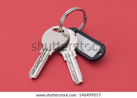 Close up of keys on red background