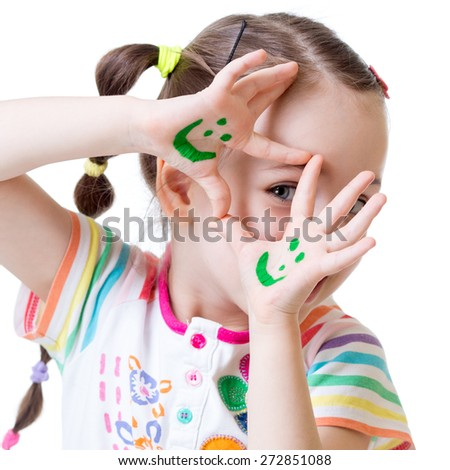 close-up of kid girl showing painted hands with funny faces - stock photo