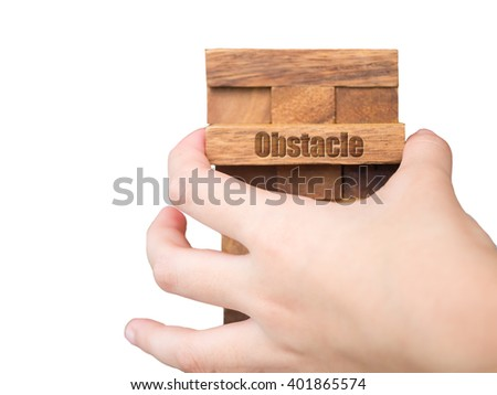 Close up of kid's hand pull out wood block - stock photo