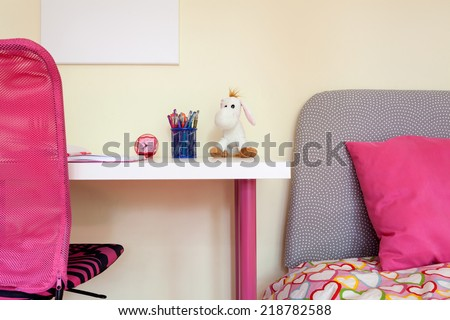 Close-up of kids room with study desk and bed - stock photo