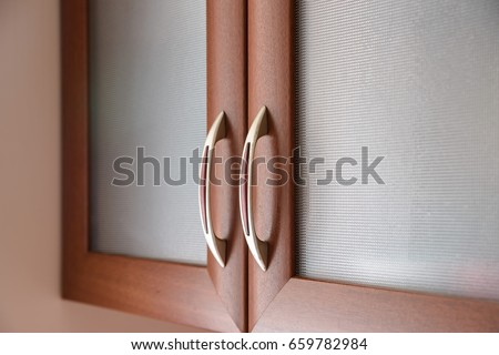 kitchen cabinet door. Close up of kitchen cabinet door handles Cabinet Door Stock Images  Royalty Free Vectors