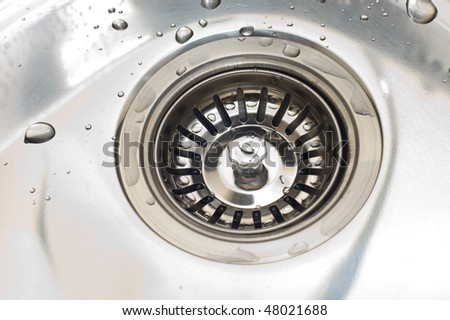 Close-up of kitchen sink with water drops - stock photo