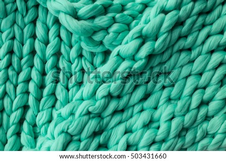 Close-up of knitted blanket, merino wool background