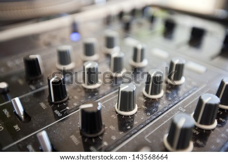 Close up of knobs on audio console - stock photo