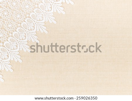 Close up of Lace flowers frame over Fabric design for border or background