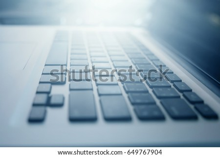 Close up of laptop keyboard with sunlight. selective focus