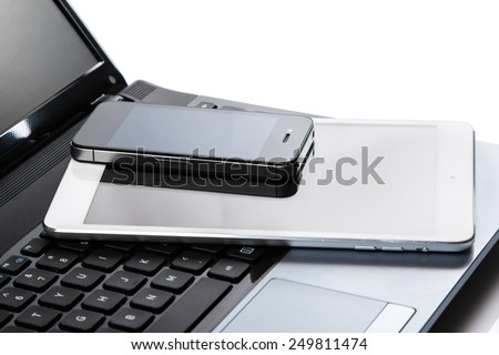 Close up of laptop, tablet and smartphone - stock photo