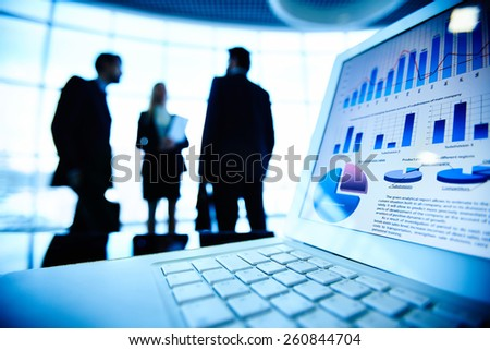 Close-up of laptop with financial data - stock photo
