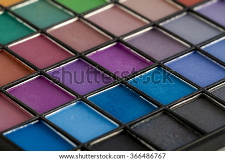 Close up of large colorful palette filled with matte and shimmering eye shadow shades
