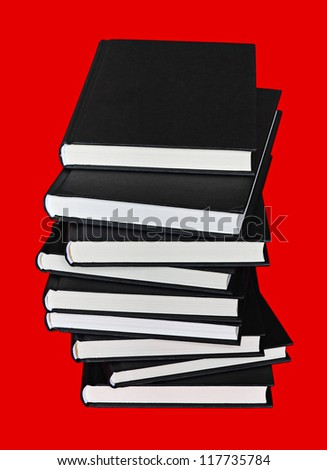 Close up of large pile of books with black cover over red background