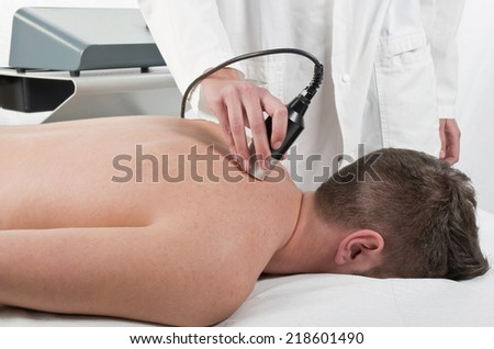Close-up of laser treatment at physiotherapy - stock photo