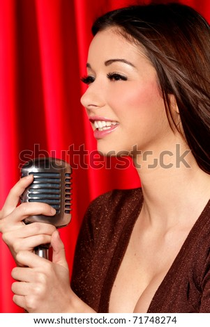 Close up of latina singer holding microphone