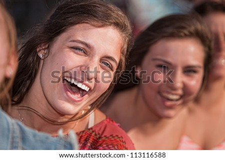Close up of laughing European teenage girls outdoors - stock photo
