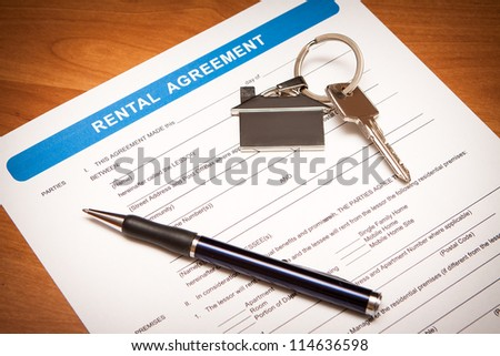 Close up of lease agreement empty document with pen - stock photo