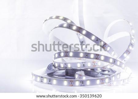 Close up of Led stripe light on white background - stock photo