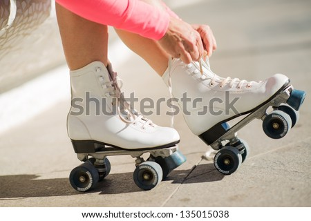 Close-up Of Legs Wearing Roller Skating Shoe, Outdoors - stock photo