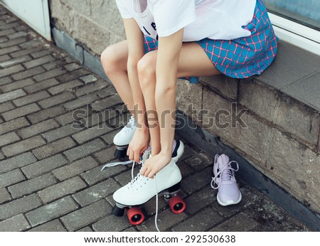 Close-up Of Legs Wearing Roller Skating Shoe, Outdoors lifestyle portrait - stock photo