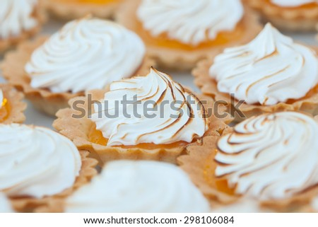 Close up of lemon meringue pie in wedding dinner - stock photo
