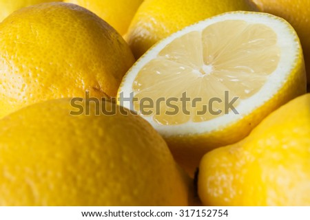 Close up of lemons, one  halved.