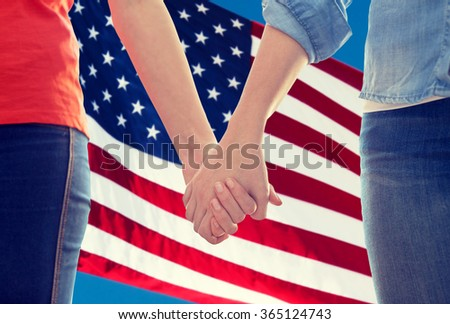 close up of lesbian couple holding hands