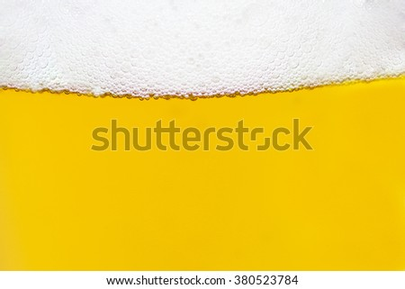 Close Up of Light Beer with Foam and Bubbles. - stock photo