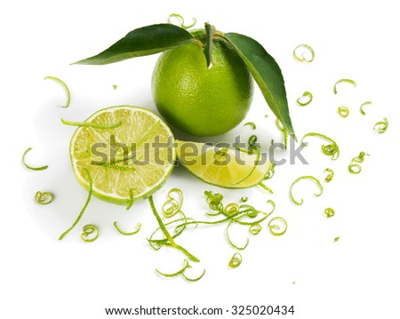 Close up of lime and zest isolated a white background