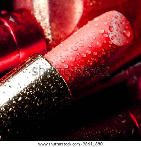 Close-up of lipstick with drops of water - stock photo