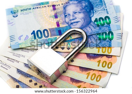 Close up of lock and money, isolated on the white secured - stock photo