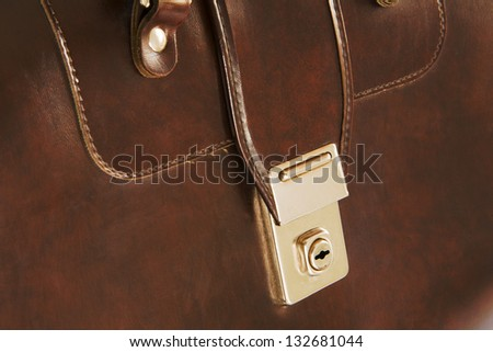 close-up of lock on leather business briefcase