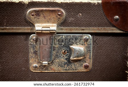 Close-up of lock on old vintage suitcase - stock photo