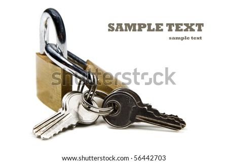 Close up of locks and keys on a white background with space for text - stock photo