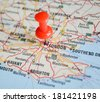 Close up of London map with red pin - Travel concept - stock photo