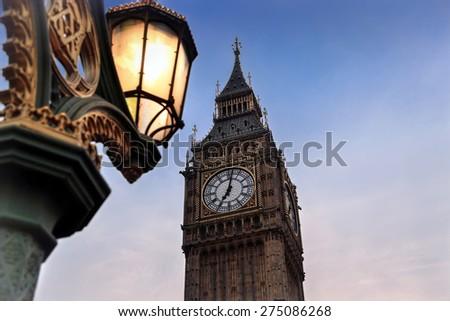 Close up of London street light and Big Ben at sunset - stock photo