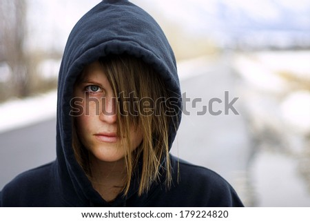 Close up of lonely teen girl - stock photo