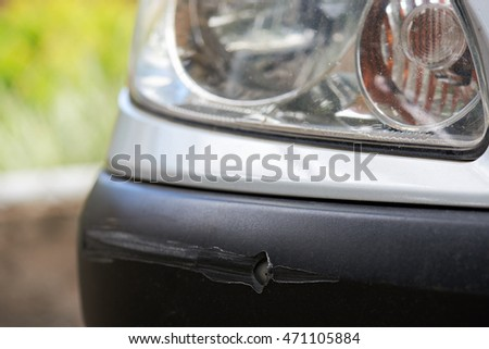 close up of  long scratch on car bumper