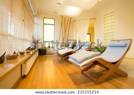Close-up of loungers in cozy spa room - stock photo