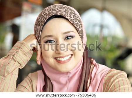 Close up of lovely Muslim girl with a sweet smile - stock photo