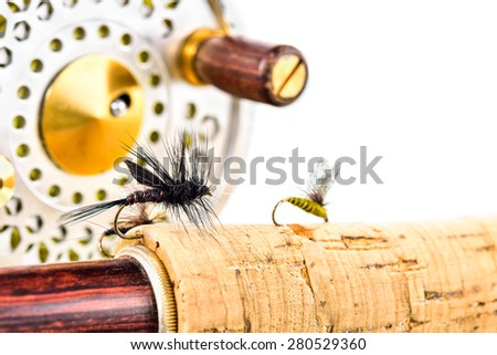 Close up of lure  fly fishing, rod and reel on white background - stock photo