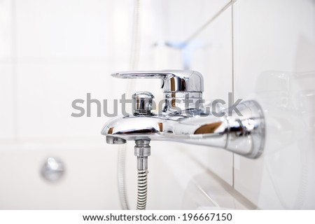 close up of luxury bathroom tap with shower in contemporary home - stock photo