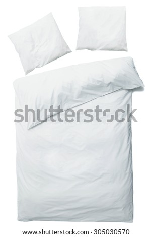 Close up of luxury blanket and pillows over white background - stock photo