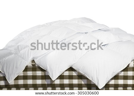 Close up of luxury duvets over white background - stock photo