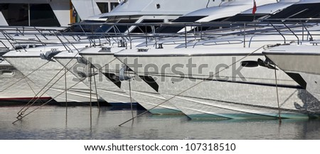 Close up of luxury yachts moored in marina - stock photo