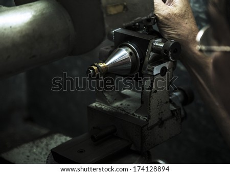 Close up of machining a golden ring - stock photo