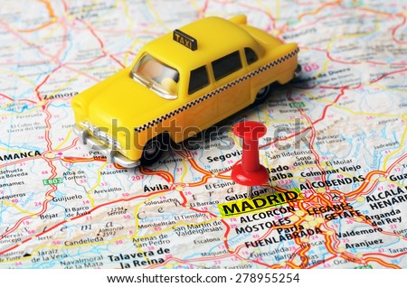 Close up of Madrid  ,Spain map  red pin and a taxi toy - Travel concept - stock photo